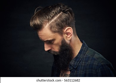Portrait of bearded male with long hair.