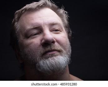 Portrait of a bearded man. Grimace.