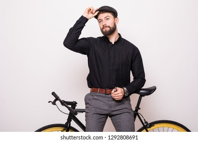 Portrait of a bearded man leaning on fixie bicycle watch over white background