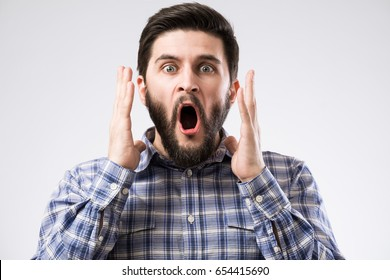 Portrait of bearded man with opened mouth and amazed emotion on face
