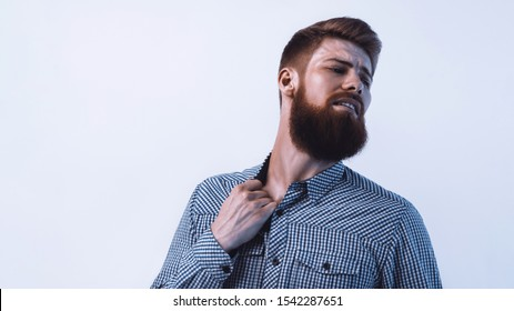 Portrait of bearded man in remorse or regret Emotional portrait White background