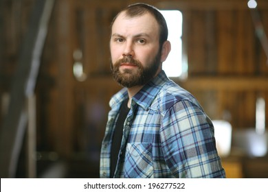 portrait of a bearded man in a rustic style