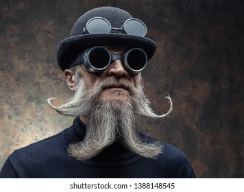 Portrait of a bearded man in with sunglasses