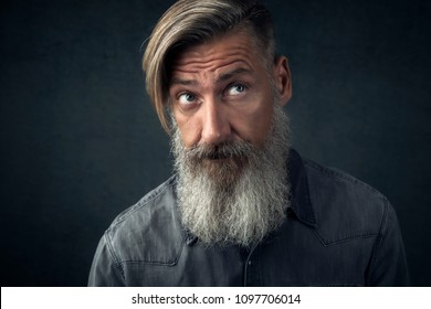 Portrait of a bearded man who is rolling with his eyes