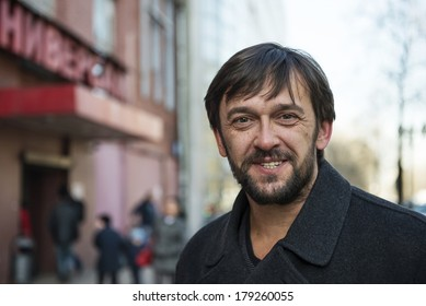 """Portrait of a Bearded mature man standing on the street. """"Real People"""" series."""