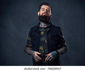 Portrait of bearded tattooed hipster male dressed in a military