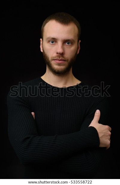 Portrait of bearded young beautiful man. Black background