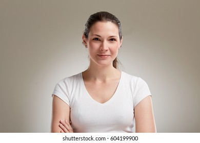Portrait of beautiful 20s woman on neutral background
