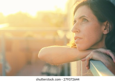 Portrait of beautiful 35 years old woman on sunset colors