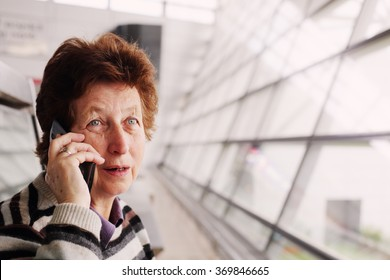 Portrait of beautiful 70 years old woman with mobile phone