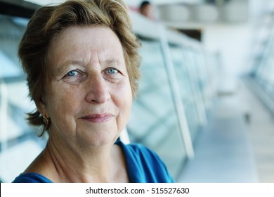 Portrait of beautiful 70 years old woman sitting in the indoor cafe