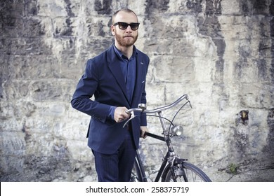 Portrait of beautiful adult man with bike