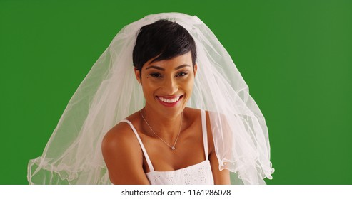 Portrait of beautiful African American bride smiling at camera on green screen