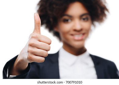 portrait of beautiful african american businesswoman showing thumb up, isolated on white