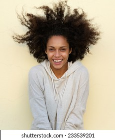 Portrait of a beautiful african american woman with curly hair laughing