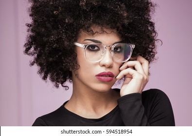 Portrait of beautiful african american young woman. Girl with afro and eyeglasses.