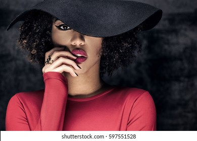 Portrait of beautiful african american young woman in black hat.