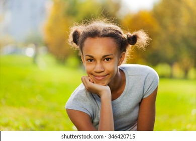 Portrait of beautiful African girl on green grass