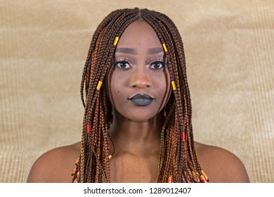 Portrait of beautiful african girl with pigtails and nude shoulders.