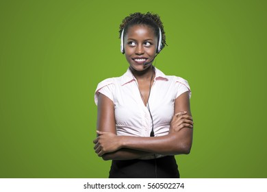 Portrait of a beautiful african secretary with handset. Online
