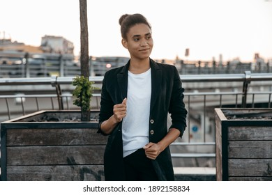 Portrait of beautiful African student  wearing suit  in urban city background.