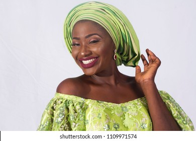 Portrait of beautiful African woman in green traditional dress