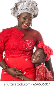 Portrait of  beautiful African woman with little girl in traditional red costume on white background