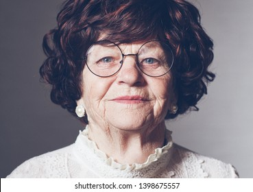 portrait of beautiful aged adult woman in glasses, 80 years old