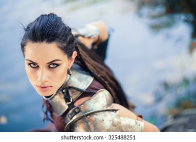 Portrait of the beautiful Amazons by the lake, closeup