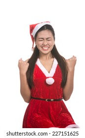 Portrait of beautiful, anxious Asian girl wearing Santa Claus clothes.