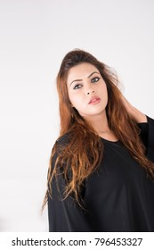 Portrait of beautiful arab woman on white background