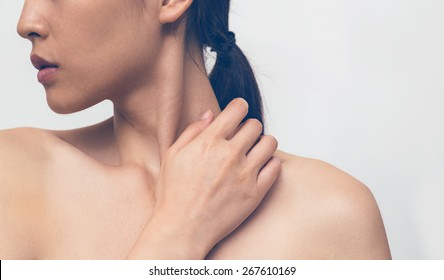 Portrait of beautiful asia woman touching her neck / color tone changed / isolated