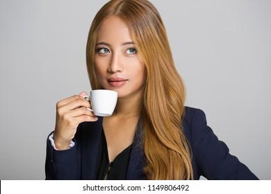 Portrait of beautiful asian businesswoman having coffee.