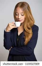 Portrait of beautiful asian businesswoman having coffee.