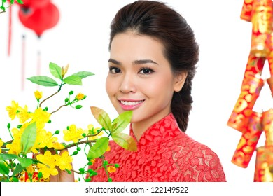 Portrait of a beautiful Asian girl at apricot tree on traditional festival