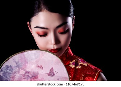 e47ad9031 portrait of a beautiful Asian girl with a bright red make-up and a Chinese