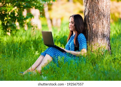 Portrait beautiful  asian girl on nature with laptop