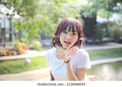 Portrait beautiful asian girl shouting and smile in nature leaves outdoor