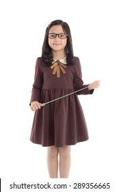 Portrait of beautiful asian girl wearing uniform and holding wand on white background isolated