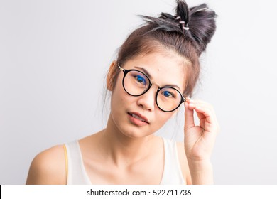 Portrait of beautiful Asian glasses woman on white in cozy room