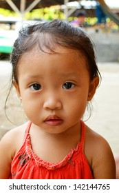 A portrait of beautiful asian little girl with innocent eyes