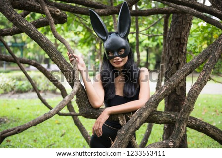 c469a0cbb29 Portrait of beautiful Asian sexy tan woman with black dress outfit and rabbit  bunny ear mask
