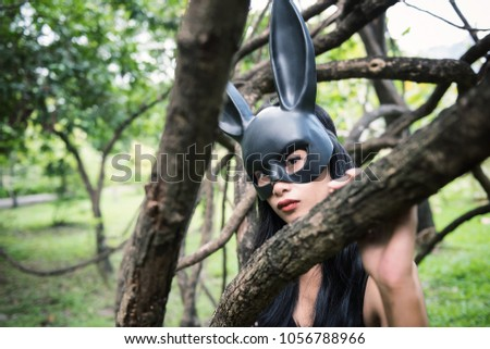 ef217259961 Portrait of beautiful Asian sexy terrify woman with fit black dress outfit  and rabbit bunny ear