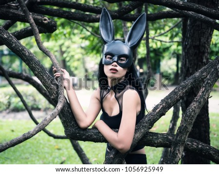 ec66683796d Portrait of beautiful Asian sexy terrify tan woman with fit black dress  outfit and rabbit bunny