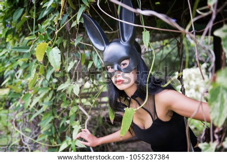 86ce72407f3 Portrait of beautiful Asian sexy woman with black dress outfit and rabbit  bunny ear mask in