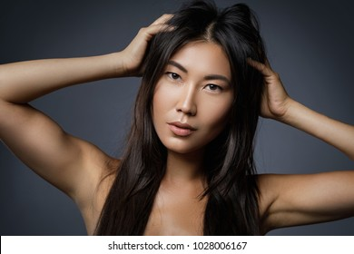 Portrait of beautiful asian woman with a black healthy hair