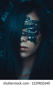 Portrait of beautiful asian woman with black lace mask over her eyes