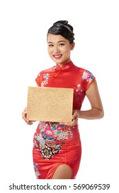 Portrait of beautiful Asian woman in Chinese traditional dress holding a gift