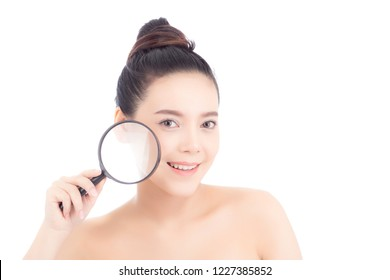 Portrait of beautiful asian woman with clean fresh face, girl magnifying skincare cheek and smile attractive, face of beauty perfect with wellness isolated on white background with healthcare concept.