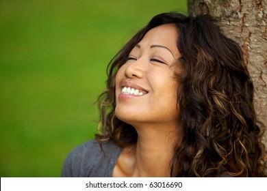 Portrait of beautiful Asian woman enjoying outdoor weather